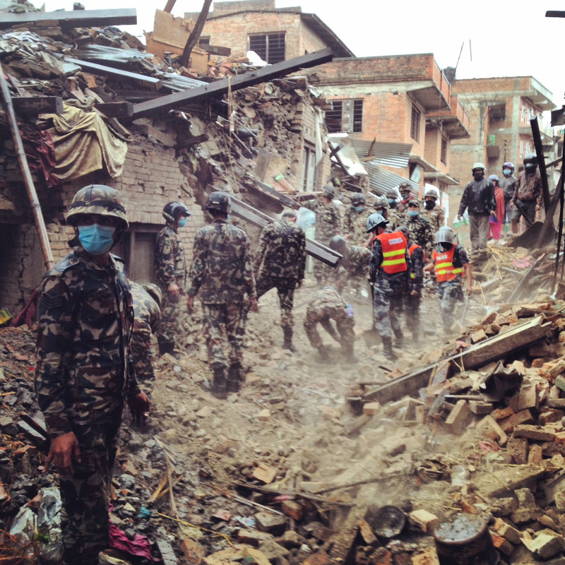Nepalese army members search for survivors in the city of Buaktapur, eight kilometres from Kathmandu. The devastating earthquake of Saturday 25th April was the worst to hit Nepal in 80 years. The death toll is expected to reach 10,000, with hundreds of thousands more people in desperate need of food, medicine and shelter.