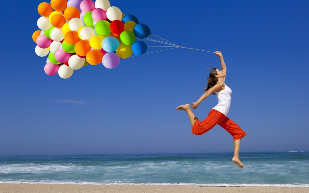 Youngster-girl-with-balloons-happy
