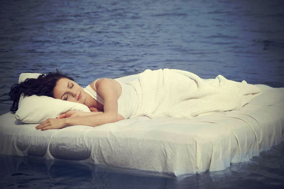 Woman-sleeping-and-dreaming-on-white-bed